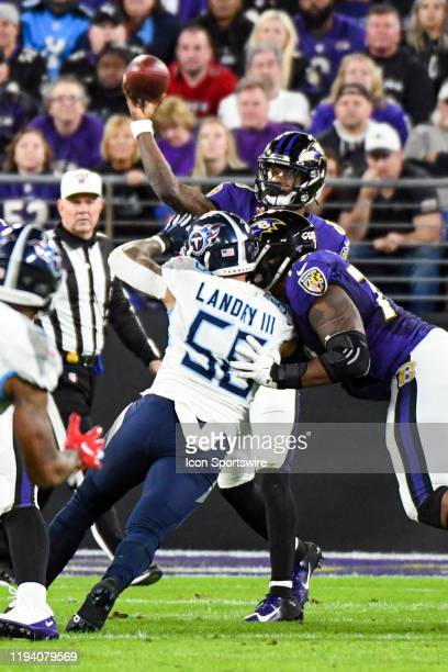 Baltimore Ravens quarterback Lamar Jackson throws under pressure from Tennessee Titans linebacker Harold Landry III on January 11 at MT Bank Stadium...