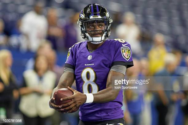 Baltimore Ravens quarterback Lamar Jackson warms up with the football prior to game action during the preseason NFL game between the Indianapolis...
