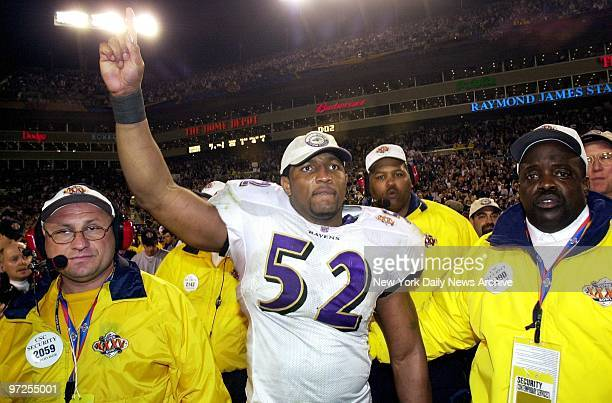 Baltimore Ravens' Ray Lewis named the game's MVP celebrates after his team crushed the New York Giants 347 at the Raymond James Stadum in Tampa to...
