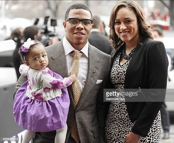 Baltimore Ravens' Ray Rice is shown with daughter Rayven and then-girlfriend, now wife Janay Palmer at the Lyric Opera House in Baltimore on March...