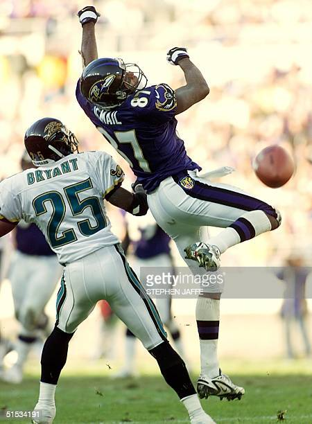 Baltimore Ravens' receiver Qadry Ismail misses the completion against Jacksonville Jaguars' Fernando Bryant in the first half of action 28 November...