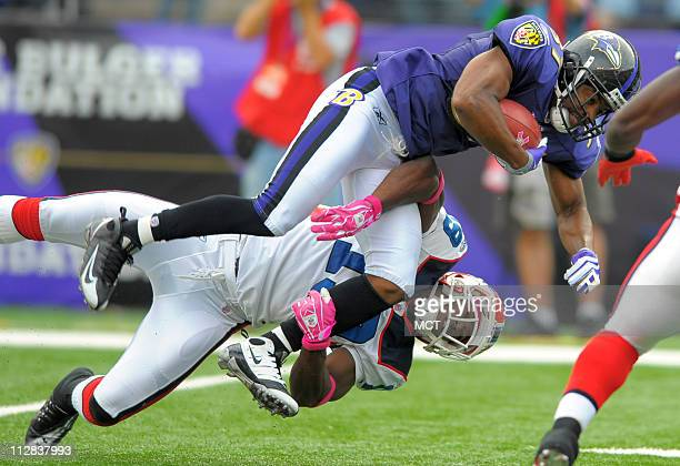 Baltimore Ravens returner Josh Wilson is upended with a diving tackle by Buffalo Bills' Donald Jones during the first half The Ravens defeated the...