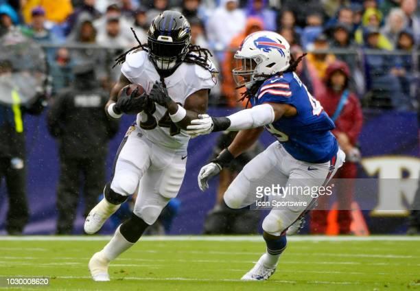 Baltimore Ravens running back Alex Collins breaks the tackle of Buffalo Bills linebacker Tremaine Edmunds on September 9 at MT Bank Stadium in...
