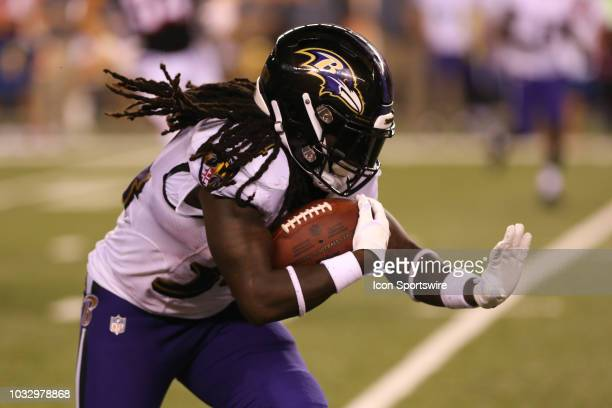 Baltimore Ravens running back Alex Collins carries the ball during the game against the Baltimore Ravens and the Cincinnati Bengals on September 13th...