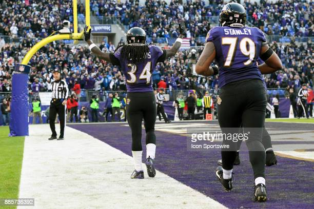 Baltimore Ravens running back Alex Collins celebrates his touchdown against the Detroit Lions on December 3 at MT Bank Stadium in Baltimore MD The...