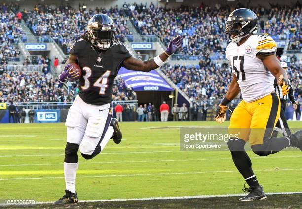 Baltimore Ravens running back Alex Collins in action against Pittsburgh Steelers inside linebacker Jon Bostic on November 4 at MT Bank Stadium in...