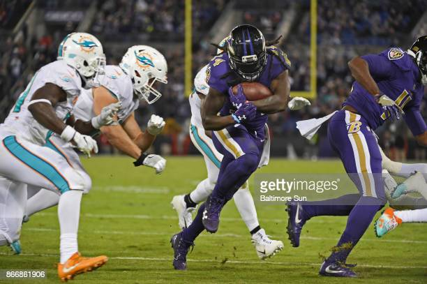 Baltimore Ravens running back Alex Collins middle runs for a 4yard gain to the Miami Dolphins' 5yardline in the second quarter at MT Bank Stadium in...