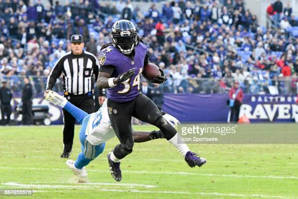 Baltimore Ravens running back Alex Collins runs for 6 yard touchdown in the fourth quarter against the Detroit Lions on December 3 at MT Bank Stadium...
