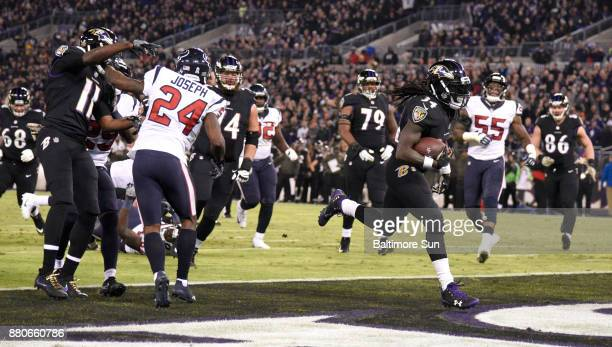 Baltimore Ravens running back Alex Collins rushes for a touchdown in the second quarter against the Houston Texans on Monday Nov 27 2017 at MT Bank...