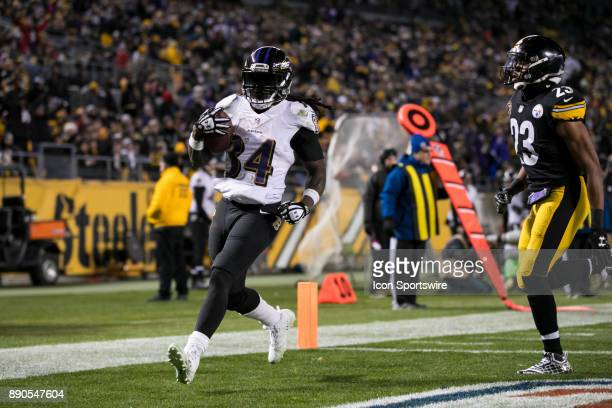 Baltimore Ravens Running back Alex Collins scores a rushing touchdown during the game between the Baltimore Ravens and the Pittsburgh Steelers on...