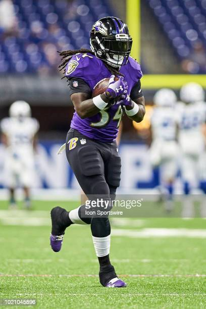 Baltimore Ravens running back Alex Collins warms up with the football prior to game action during the preseason NFL game between the Indianapolis...