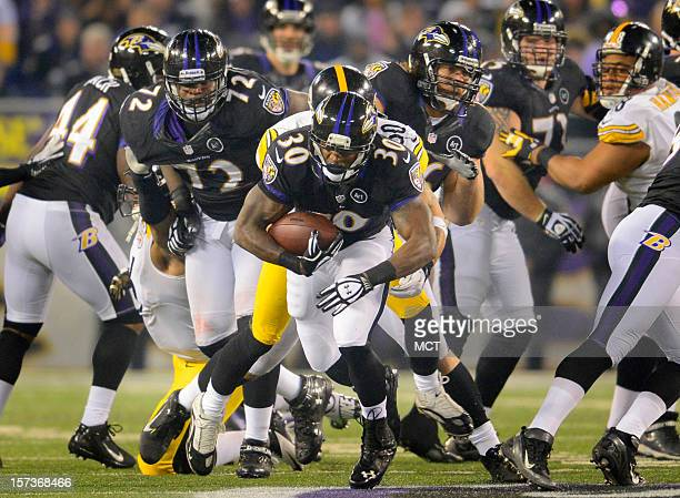 Baltimore Ravens running back Bernard Pierce breaks into the clear on a run from scrimmage during the second half of their game in Baltimore,...