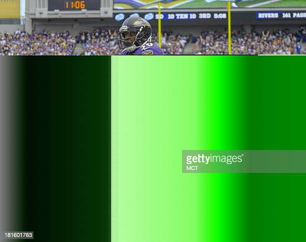 Baltimore Ravens running back Bernard Pierce escapes the grasp of Houston Texans linebackers Darryl Sharpton and outside linebacker Brooks Reed as he...