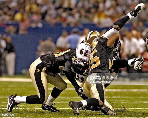 Baltimore Ravens running back Chester Taylor is upended during a preseason game against the New Orleans Saints at the Superdome in New Orleans...