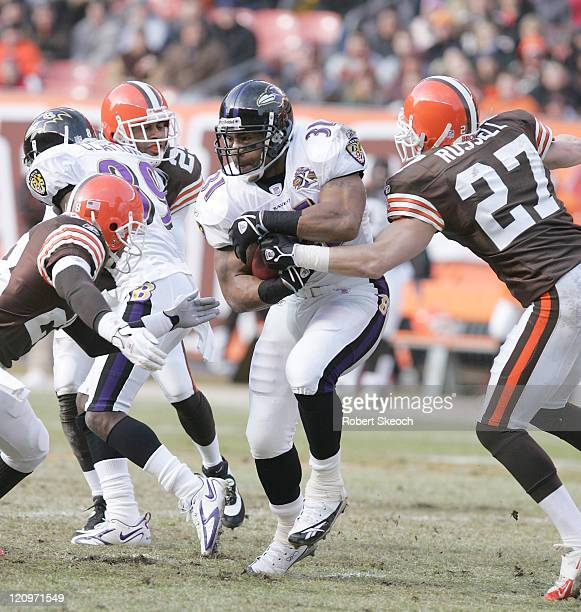 Baltimore Ravens running back Jamal Lewis fights for yards during the game against the Cleveland Browns at Cleveland Browns Stadium in Cleveland Ohio...