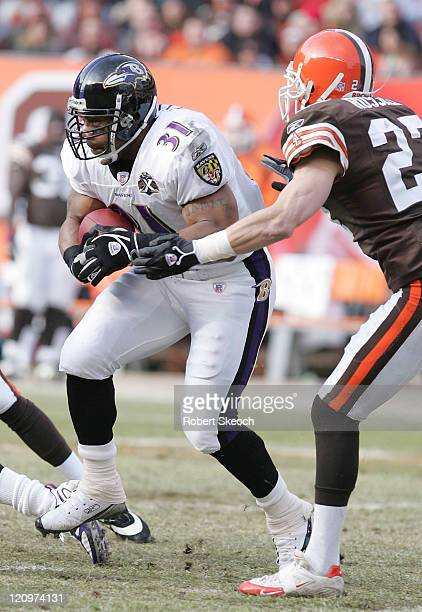 Baltimore Ravens running back Jamal Lewis scrambles for yards during the game against the Cleveland Browns at Cleveland Browns Stadium in Cleveland...