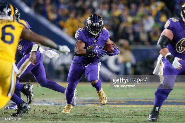 Baltimore Ravens running back Mark Ingram bust through a hole during the Baltimore Ravens vs Los Angeles Rams football game on November 25 at the Los...