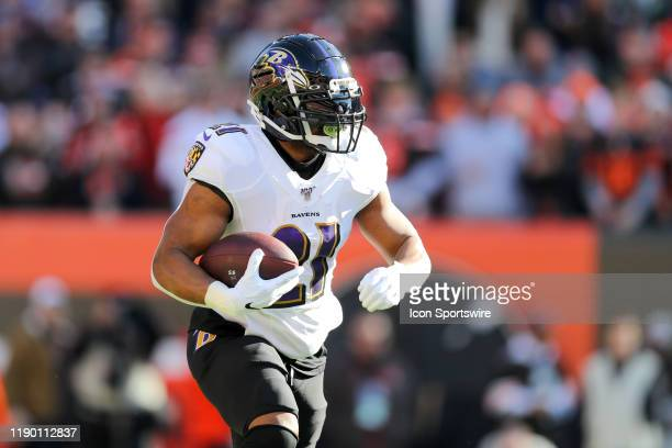 Baltimore Ravens running back Mark Ingram II carries the football during the first quarter of the National Football League game between the Baltimore...