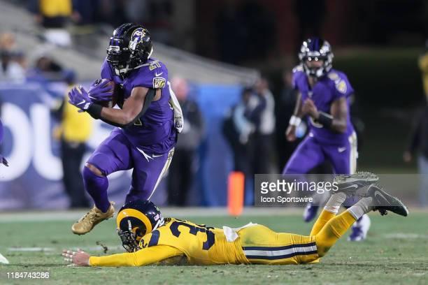 Baltimore Ravens running back Mark Ingram runs through Los Angeles Rams free safety Eric Weddle during the Baltimore Ravens vs Los Angeles Rams...
