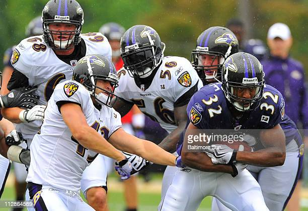 Baltimore Ravens running back Matt Lawrence carries the ball past safety Haruki Nakamura left during practice at Ravens training camp at McDaniel...