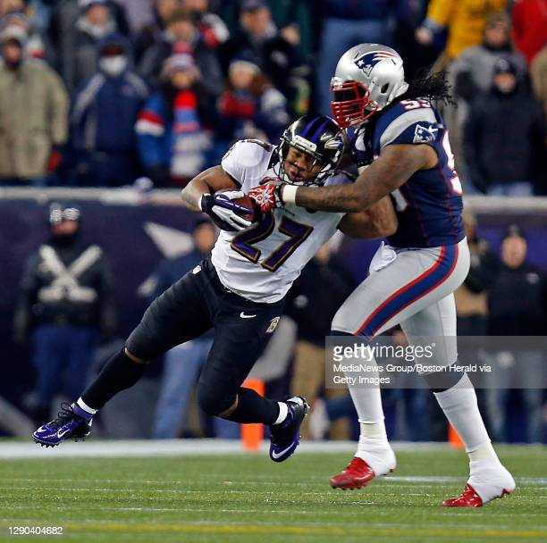 Baltimore Ravens running back Ray Rice, left, is brought down by New England Patriots linebacker Brandon Spikes during the second quarter of the AFC...
