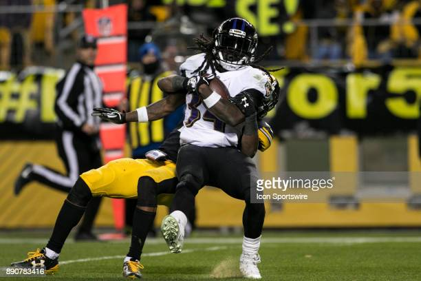 Baltimore Ravens Running back running back Alex Collins is brought down while scoring a touchdown during the game between the Baltimore Ravens and...