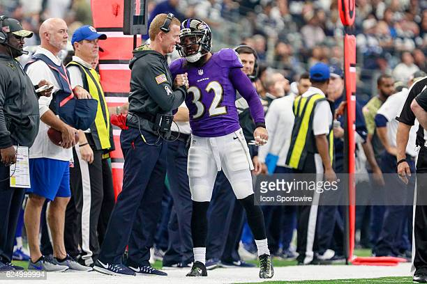Baltimore Ravens Safety Eric Weddle shakes the hand of Dallas Cowboys Head Coach Jason Garrett during the NFL game between the Baltimore Ravens and...