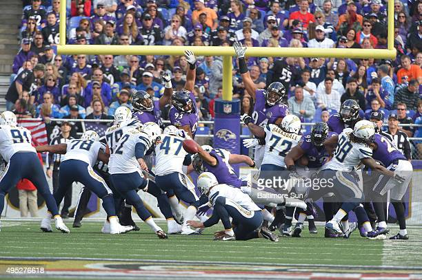 Baltimore Ravens special teams player Asa Jackson blocks an extra point during the second quarter on Sunday Nov 1 at MT Bank Stadium in Baltimore