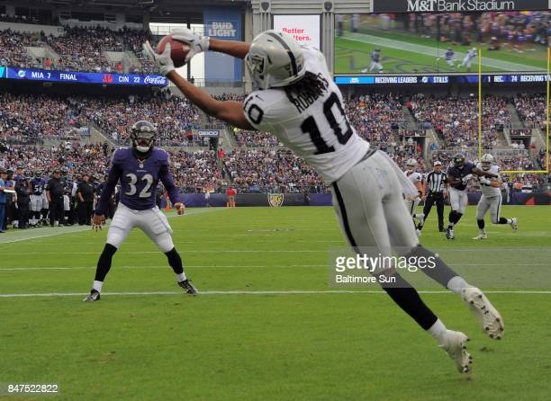 Baltimore Ravens strong safety Eric Weddle watches Oakland Raiders wide receiver Seth Roberts make a touchdown reception during the first quarter on...