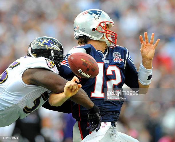 Baltimore Ravens Terrell Suggs forces a fumble as New England Patriots quarterback Tom Brady tries to pass in thirdquarter action The fumble was...