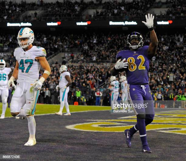 Baltimore Ravens tight end Benjamin Watson right celebrates a 2yard touchdown catch in front of Miami Dolphins linebacker Kiko Alonso in the second...