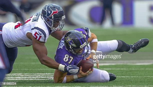 Baltimore Ravens tight end Dallas Clark makes a first down reception before getting taken down by Houston Texans inside linebacker Darryl Sharpton...