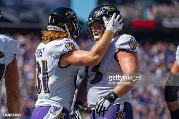Baltimore Ravens tight end Hayden Hurst celebrates catching a touchdown pass during the first half of the National Football League game between the...