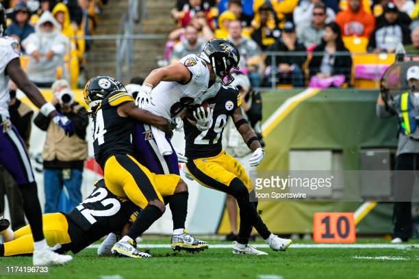 Baltimore Ravens tight end Hayden Hurst fights for extra yards during the NFL football game between the Baltimore Ravens and the Pittsburgh Steelers...