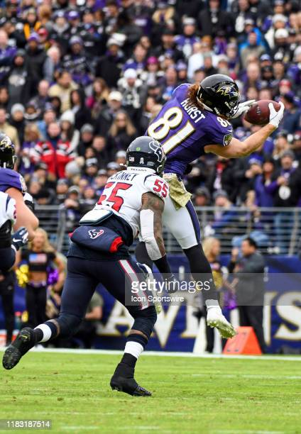 Baltimore Ravens tight end Hayden Hurst makes a second quarter reception against Houston Texans inside linebacker Benardrick McKinney on November 17...