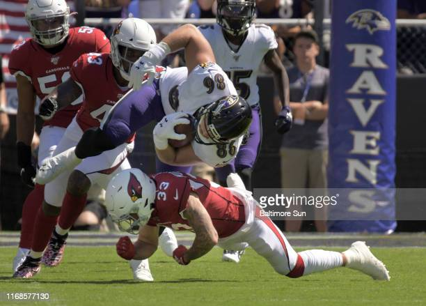 Baltimore Ravens tight end Nick Boyle barrels over Arizona Cardinals cornerback Byron Murphy Jr. For a first down during the first quarter of the...