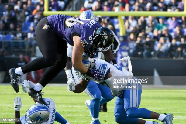 Baltimore Ravens tight end Nick Boyle makes a first quarter pass reception and is brought down by Detroit Lions free safety Glover Quin on December 3...