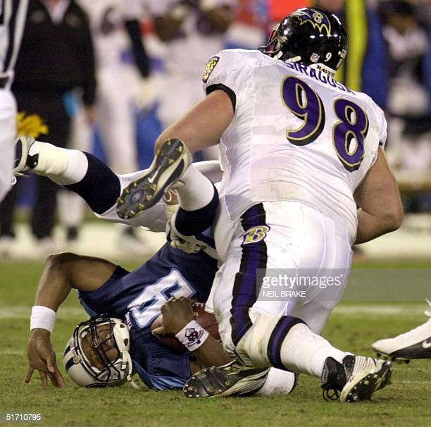 Baltimore Ravens' Tony Siragusa sacks Tennessee Titans' quarterback Steve McNair during NFL action 12 November 2001 at Adelphia Coliseum in Nashville...