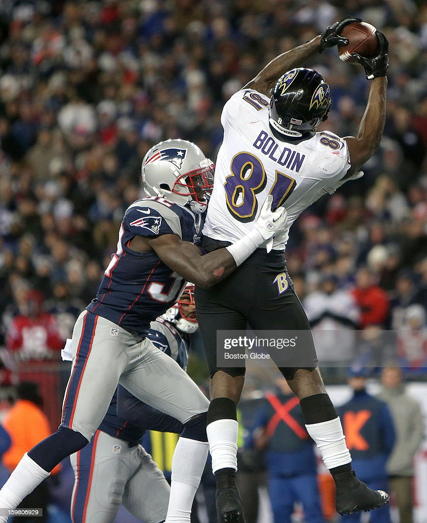 Baltimore Ravens wide receiver Anquan Boldin (#81) beats New England Patriots free safety Devin McCourty (#32) as he takes to the air for a touchdown in the fourth quarter to give the Baltimore Ravens a 21-13 lead as the New England Patriots hosted the Baltimore Ravens in the AFC Championship Game at Gillette Stadium.
