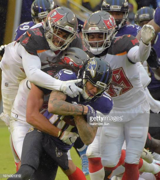 Baltimore Ravens wide receiver Chris Moore gains yardage to the 45-yrd line, tackled by Tampa Bay Buccaneers linebacker Devante Bond and safety...