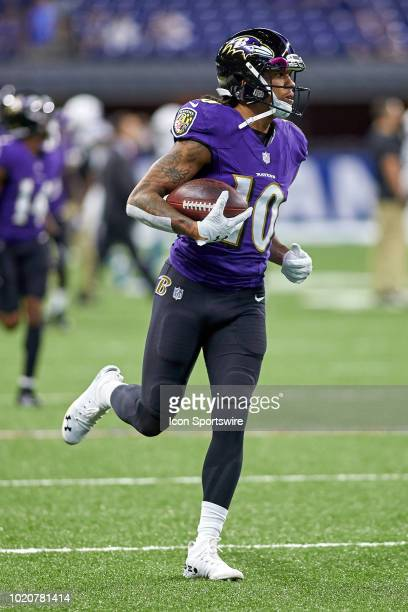 Baltimore Ravens wide receiver Chris Moore warms up with the football prior to game action during the preseason NFL game between the Indianapolis...