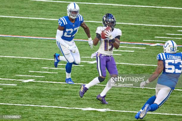 Baltimore Ravens wide receiver Marquise Brown battles with Indianapolis Colts cornerback Xavier Rhodes to catch the football in action during a NFL...