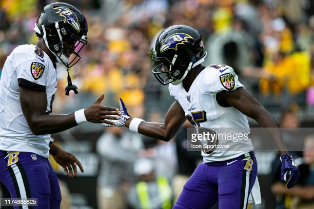 Baltimore Ravens wide receiver Marquise Brown celebrates with Baltimore Ravens quarterback Lamar Jackson after a touchdown during the NFL football...