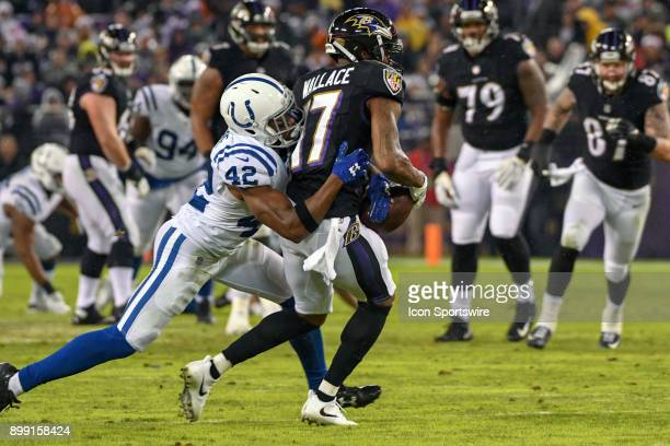 Baltimore Ravens wide receiver Mike Wallace hangs on to pass defended by Indianapolis Colts defensive back Kenny Moore on December 23 at MT Bank...