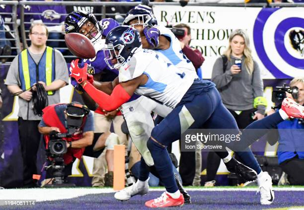 Baltimore Ravens wide receiver Miles Boykin cannot catch a two point conversion attempt against the defense of Tennessee Titans free safety Kevin...