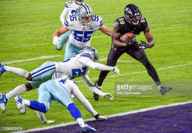 Baltimore Ravens wide receiver Miles Boykin catches a 38 yard touchdown pass in the second quarter against Dallas Cowboys free safety Xavier Woods...