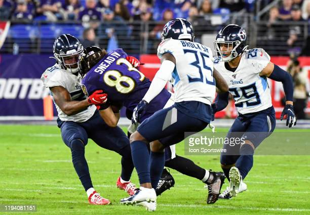 Baltimore Ravens wide receiver Willie Snead IV is brought down by Tennessee Titans free safety Kevin Byard on January 11 at MT Bank Stadium in...