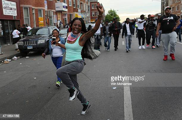Baltimore residents celebrate at the intersection of West North Avenue and Pennsylvania Avenue near the location where Freddie Gray was arrested...