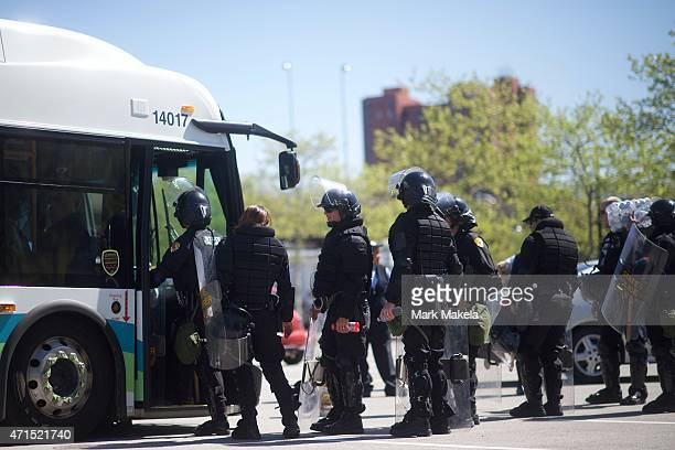 Baltimore riot police line up to board a bus following days of citywide riots and protests regarding the death of Freddie Gray on April 29, 2015 in...