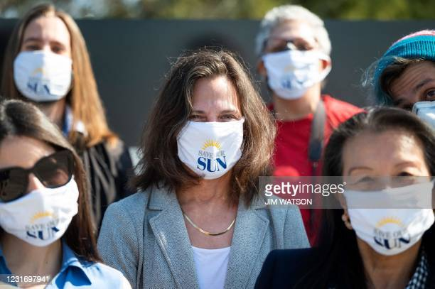 Baltimore Sun reporter Liz Bowie wears a Save Our Sun facemask with other reporters during an interview in Baltimore, Maryland on March 11, 2021. -...